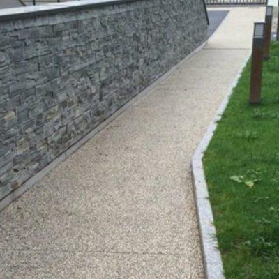 Mur béton avec parement imitation pierre pour une opération immobilière à Annecy, 74000